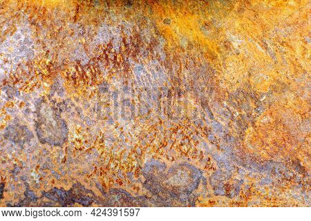 Rusty Surface Of A Metal Sheet Close-up. Corrosion Steel And Iron Texture Background.