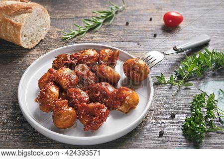 A Plate With Greek Style Mushrooms, Bread, Condiments And Spices On A Dark Wooden Background