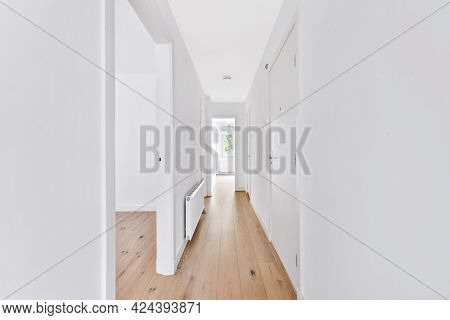 Bright White Walls And Interior Details Of Long Corridor In Modern House