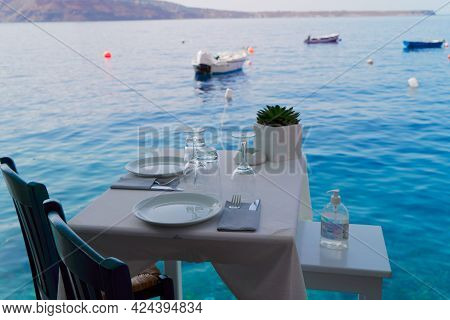 Relaxing Chairs And Dinner Table With View Of Sea And Caldera, Santorini, Greece