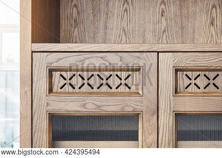 Stylish Part Of Large Cabinet Made Of Light Toned Veneer And Solid Ash Timber With Decorative Glass