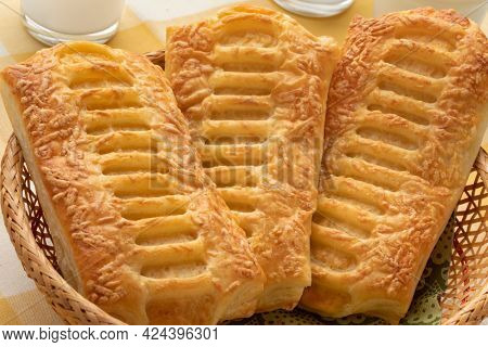 Crispy cheese puff pastry snack for lunch close up in a basket