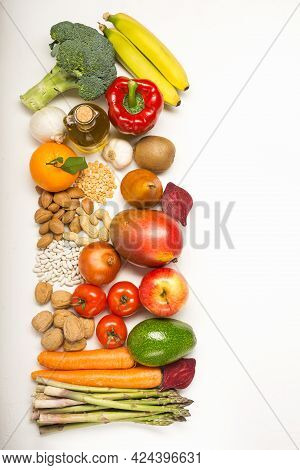 Fresh Fruits And Vegetables On The White Background With Space For Text