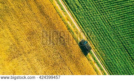 Aerial View Of Car Suv Parked Near Countryside Road In Spring Field Rural Landscape. Car Between You