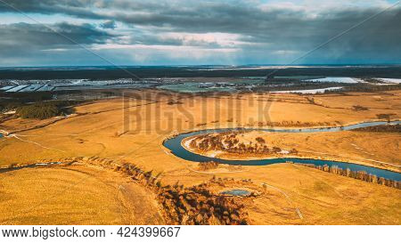 Europe. Aerial View Of Dry Grass And Partly Frozen Curved River Landscape In Autumn Day. High Attitu