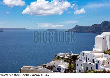 Santorini Island, Greece. Oia Caldera Over Aegean Sea, Blue Sky, Calm Sea