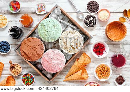 Summer Ice Cream Buffet With A Variety Of Ice Cream Flavors And Sweet Toppings. Overhead View Table