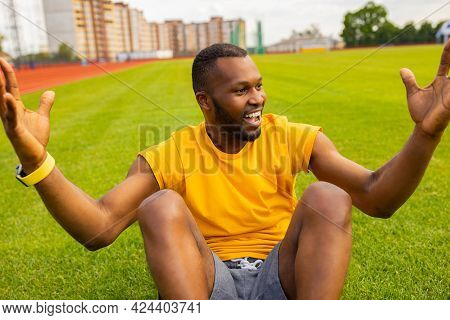 Young Handsome Sportsman African American Man In Yellow Sport Wear Cheering Carefree And Excited At