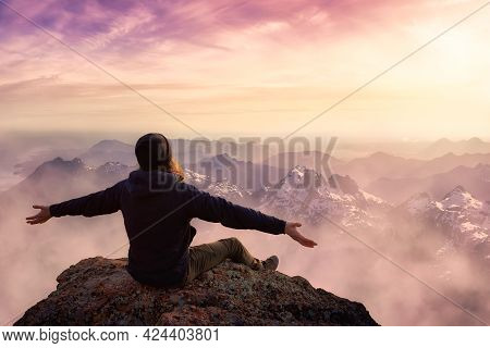 Adventure Composite. Adventurous Man With Open Hands Is Taking In The Moment On Top Of A Mountain. C