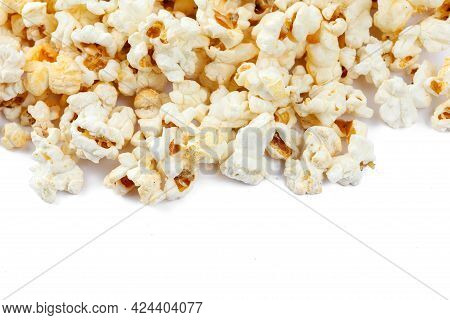 Heap Of Delicious Popcorn, Isolated On White Background. Scattered Popcorn Texture Background. Close