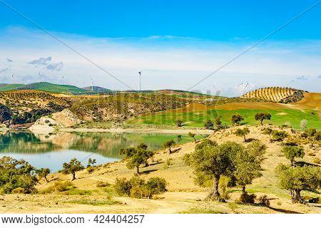 Andalucian Landscape With Wind Turbines On Hills. Lake Embalse Del Guadalhorce, Ardales Reservoir, P