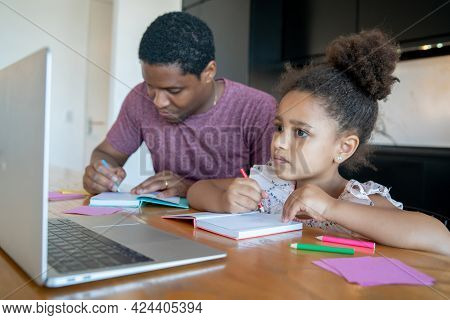 A Father Helping His Daughter With Homeschool.