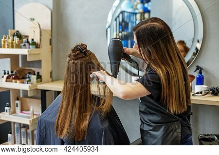 Barber Dries His Hair., Cuts Her Hair To A Girl With Long Hair. A Woman Dyes Her Hair, Dries Her Hai