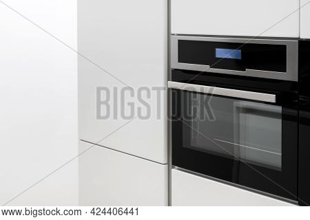 Big White Kitchen Cupboard With Built In Black Metal Electric Oven With Glass Door, Modern Convinien