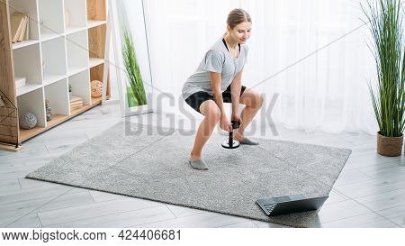 Kids Home Fitness. Online Gym. Sport Indoors. Active Leisure. Athletic Girl Doing Squat Exercise Wit