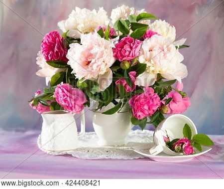 Still life with white and pink peonies in a  vase