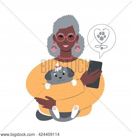 Senior African Woman With A Tiny Dog Searching For Veterinarian Online From Smartphone.
