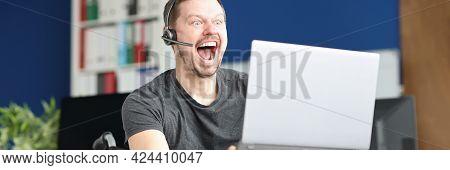 Emotionally Joyful Disabled Man Streamer Looks Into Laptop Monitor