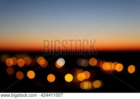 Blurred Lights Of Evening City After Sunset. Evening Sky, Colorful Abstract Background