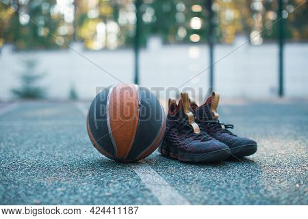 Basketball Ball, Sportive Shoes For Workout On Basketball Court, Close Up Advertising Photography In