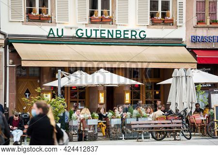Strasbourg, France - May 19, 2021: People Eating At The Au Gutenberg Terrace As Bars And Restaurants