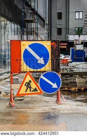 Warning Signs About Road Works. Road Signs At Site Of Sidewalk Repair, Road Works.