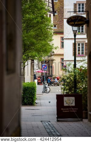 Strasbourg, France - May 19, 2021: View Through French Street At Terraces Amd Restaurants Reopen Aft