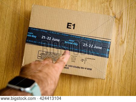 Paris, France - June 21, 2021: Pov Male Hand Pointing Amazon Parcel Cardboard With Special Markings