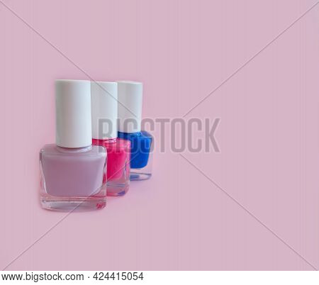 Nail Polish Bottle On A Colored Background