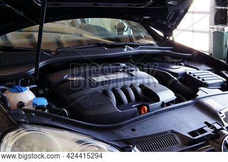 Moscow Russia - June 21 2021: Modern Car In A Car Service, The Hood Of The Car Is Open And The Engin