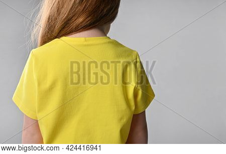 Back View Of A Detail Of Childrens Summer Wardrobe - Yellow Cotton T-shirt. Short Sleeve