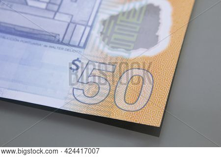 Currency Of Uruguay - Banknote Of Fifty Uruguayan Pesos, Close-up On Dark Background. Cash Money