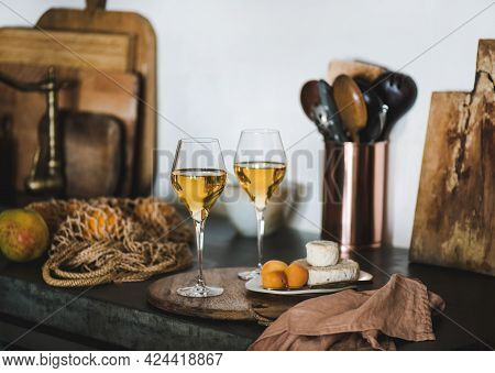 Two Glasses Of Trendy Orange Or Amber Wine And Appetizers