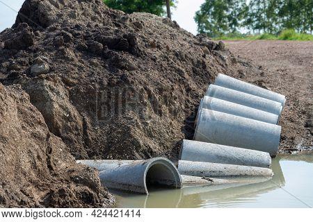 Concrete Drainage Pipe On A Construction Site, Concrete Drainage Pipes Stacked For Construction.
