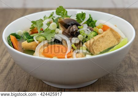 Hearty Bowl Of Tofu Pho For The Vegetarian Appetite Served In A Hearty Bowl.