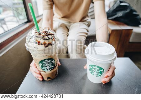 Chiang Mai, Thailand : May-15-2019 : Cropped View Of Customer Holding A Plastic Cup Of Triple Mocha
