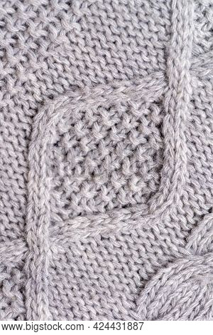 Close-up Fragment Of Knitted Gray Fabric. Diagonal Pattern In The Form Of A Diamond. The Structure O