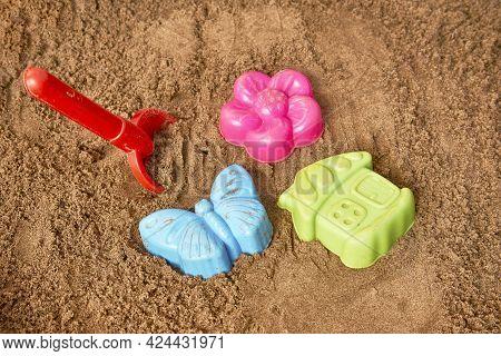 Children's Beach Toys. Plastic Toys In Sand - Shovel, Flower And Home