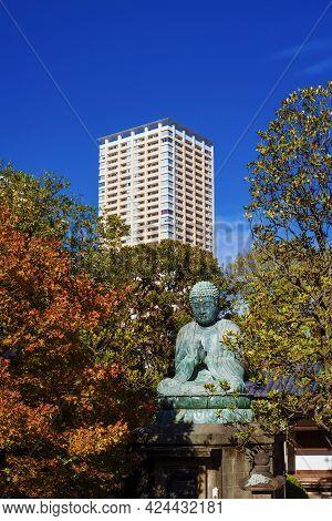 Tokyo, Japan - November 25: Japan Between Tradition And Modernity. Ancient Yanaka Great Buddha With