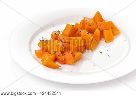 Pieces Of Baked Pumpkin In White Plate On White Background.