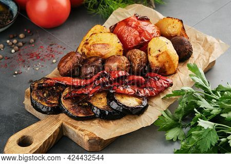 Grilled Vegetables On Wooden Board With Parchment.
