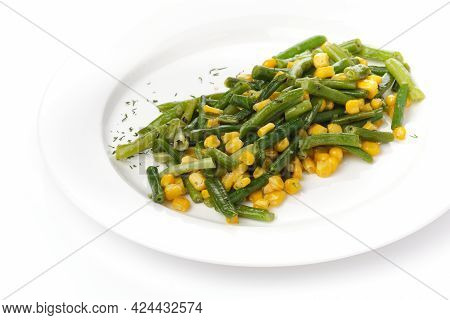 Green Beans With Corn On A White Plate On A White Bacgraund.