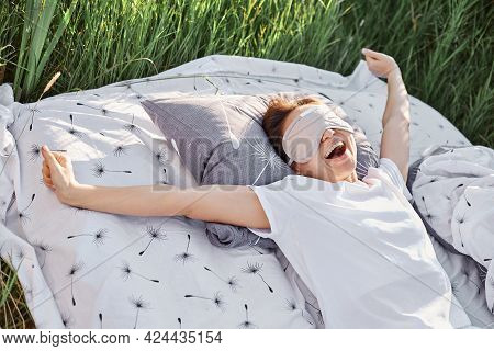 Happy Yawning Female Wearing Sleeping Fold And White Casual T-shirt Stretching Arms When Waking Up I