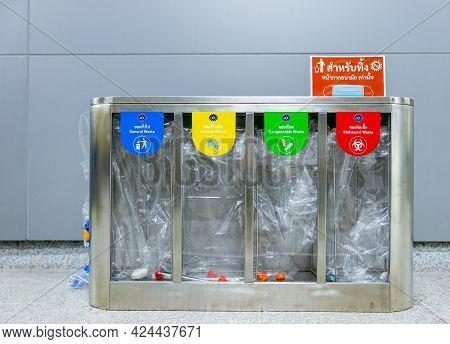 Bangkok, Thailand - 21 Jun 2021: Recycling Sorting Yellow, Green, Blue And Red Recycle Transparent B