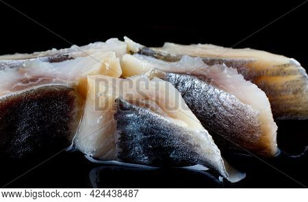 Beautifully Laid Out Pieces Of Herring On A Black Background. Fillet Of Herring.