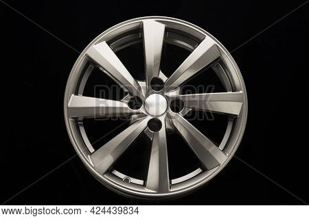 Grey Alloy Wheel, Modern Auto Parts. Black Background Front View