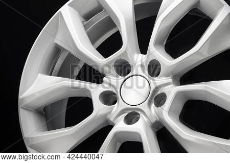 Close-up Of The Car Alloy Wheel Detail In Gray On A Black Background