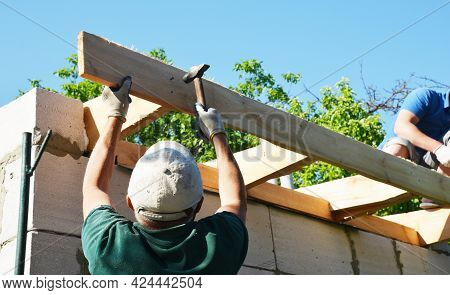 Kyiv, Ukraine - May, 22, 2021:  Roofing Construction. Roofing Contractors Are Wood Framing The Roof