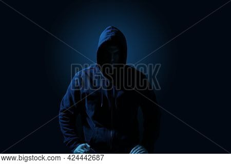 Silhouette Of Anonymous Man On Dark Background, Toned In Blue