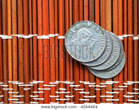Five One Peso Coins On Mat